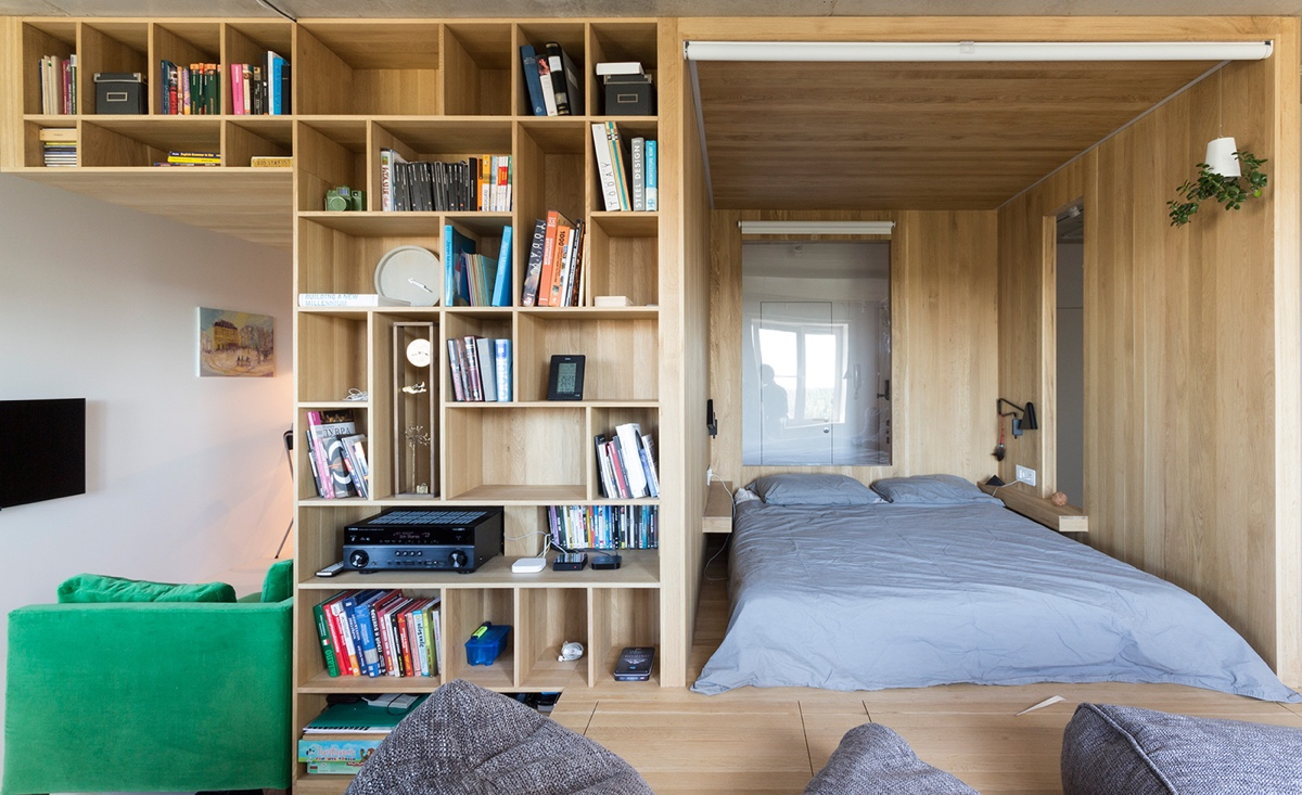 http://cdn.home-designing.com/wp-content/uploads/2016/10/Front-on-bedroom-next-to-bookcase-home-under-50sqm-five-living-spaces-in-one.jpg