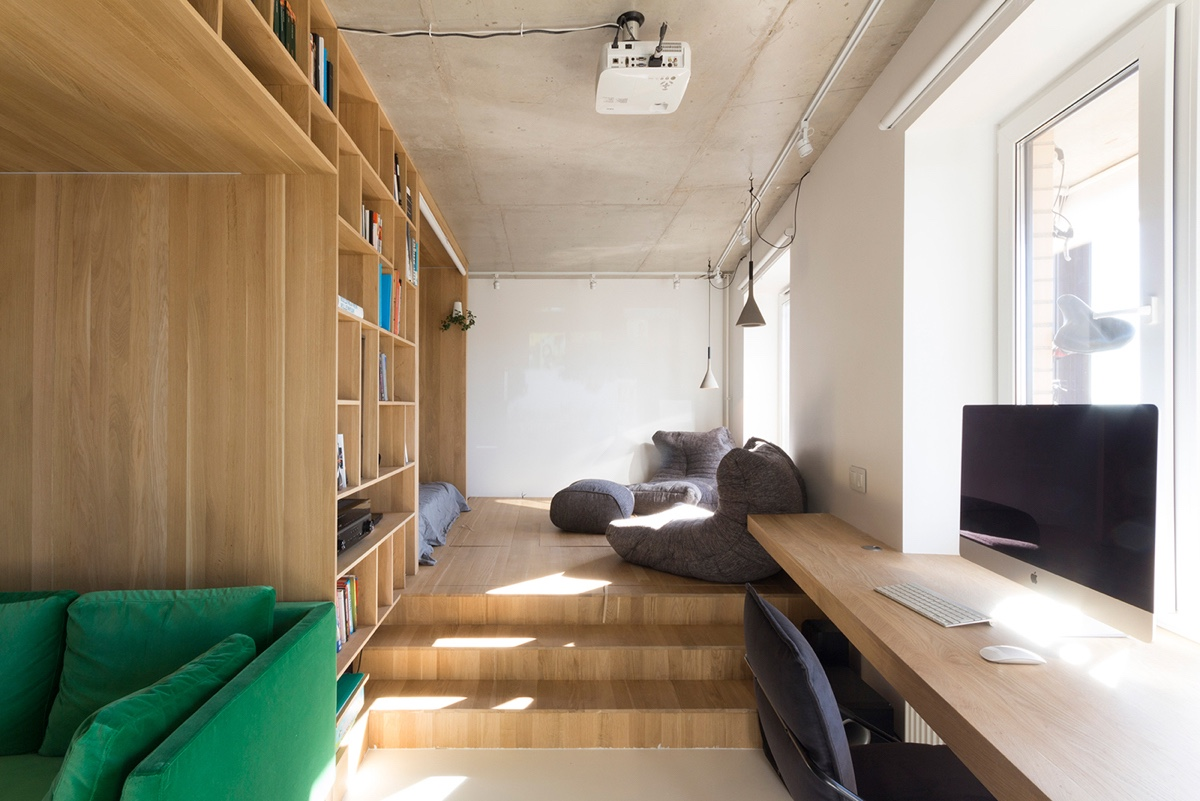 L Shaped Living Area Minimalist Wooden Bookcase And Room Partition Frame Leaf Green Velvet Couch - Super small studio apartment under 50 square meters includes floor plan