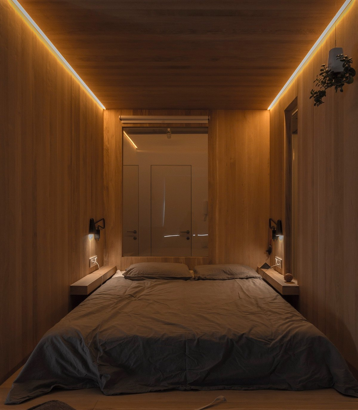 LED Lit Bedroom Wooden Walls Minimalist Grey Bedding - Super small studio apartment under 50 square meters includes floor plan