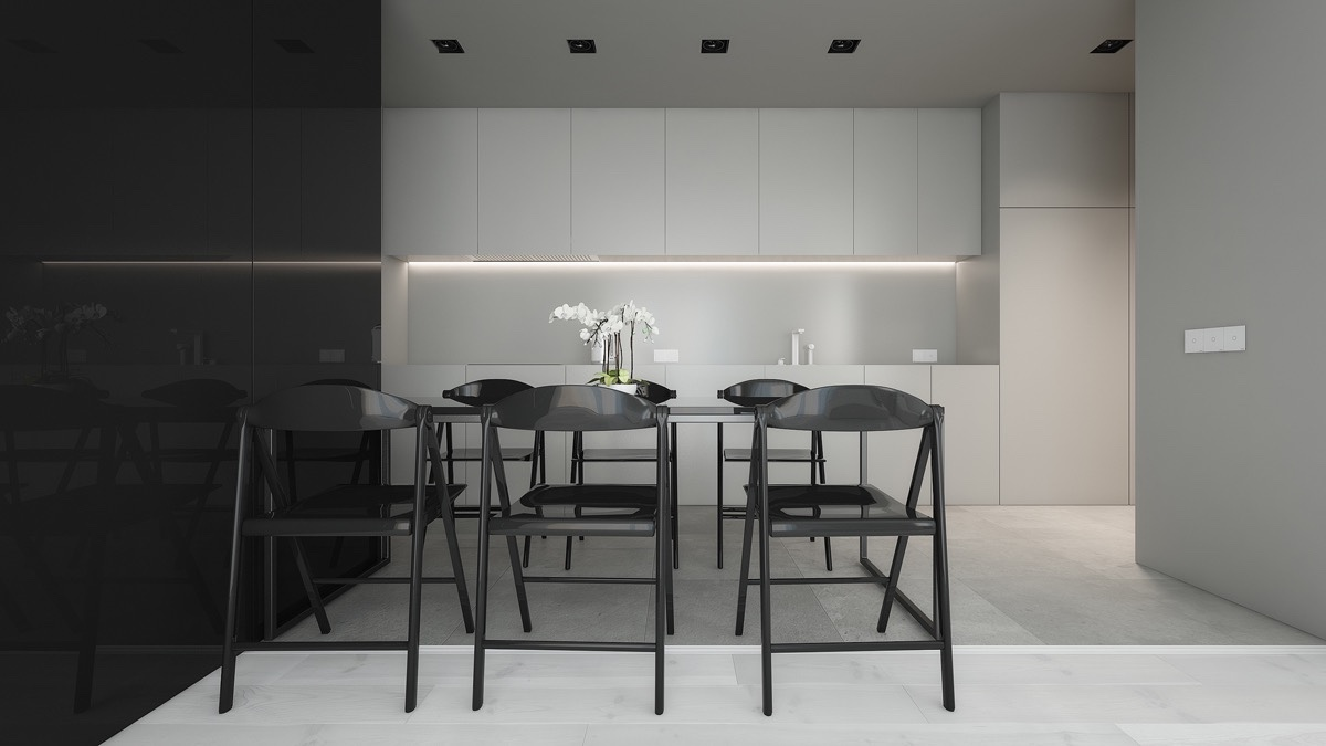A black-plastic dining table and chairs are both functional and surprisingly classic, especially when viewed against the black lacquer wall. A sprout of orchids amidst grey cabinetry and wooden flooring ties in the lounge. Seen from a grey-walled entrance, black square ceiling lights create a trail for visitors to follow.