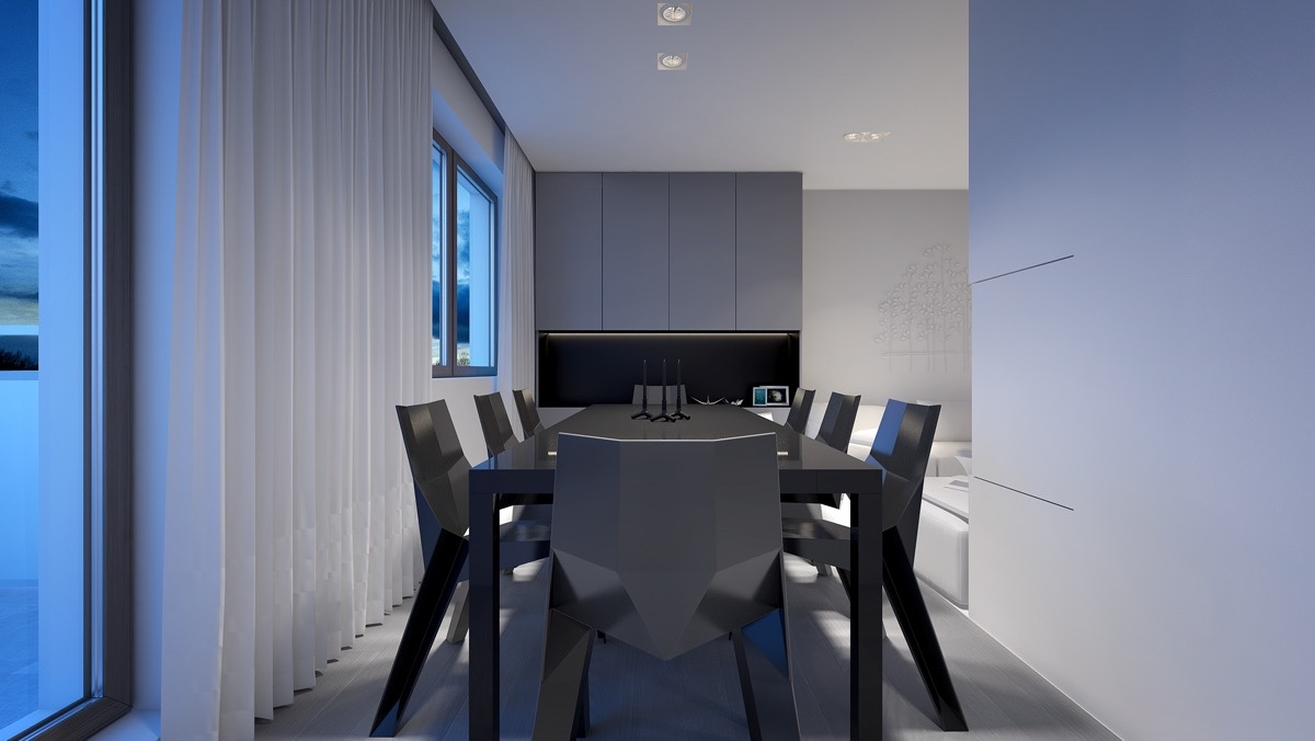 The dining area presents itself in a long, lean space, framed by ceiling-to-floor white drapery. Bordered by another white and grey corridor leading to light, it presents a clean space for talking and eating.