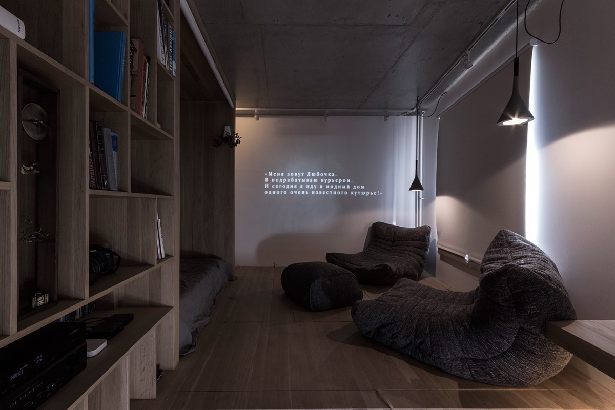 Relaxation Room With Library Compartments Hanging Grey Drop Lights - Super small studio apartment under 50 square meters includes floor plan