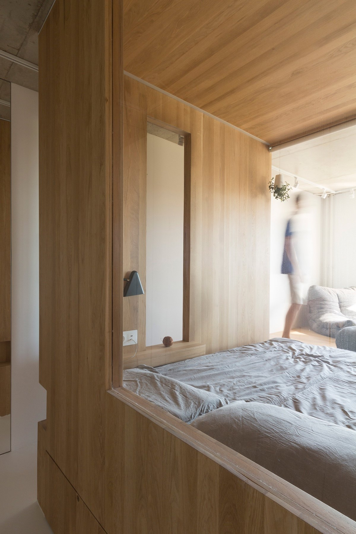 Two Indoor Windowed Bedroom Grey Bedding Wooden Walling - Super small studio apartment under 50 square meters includes floor plan