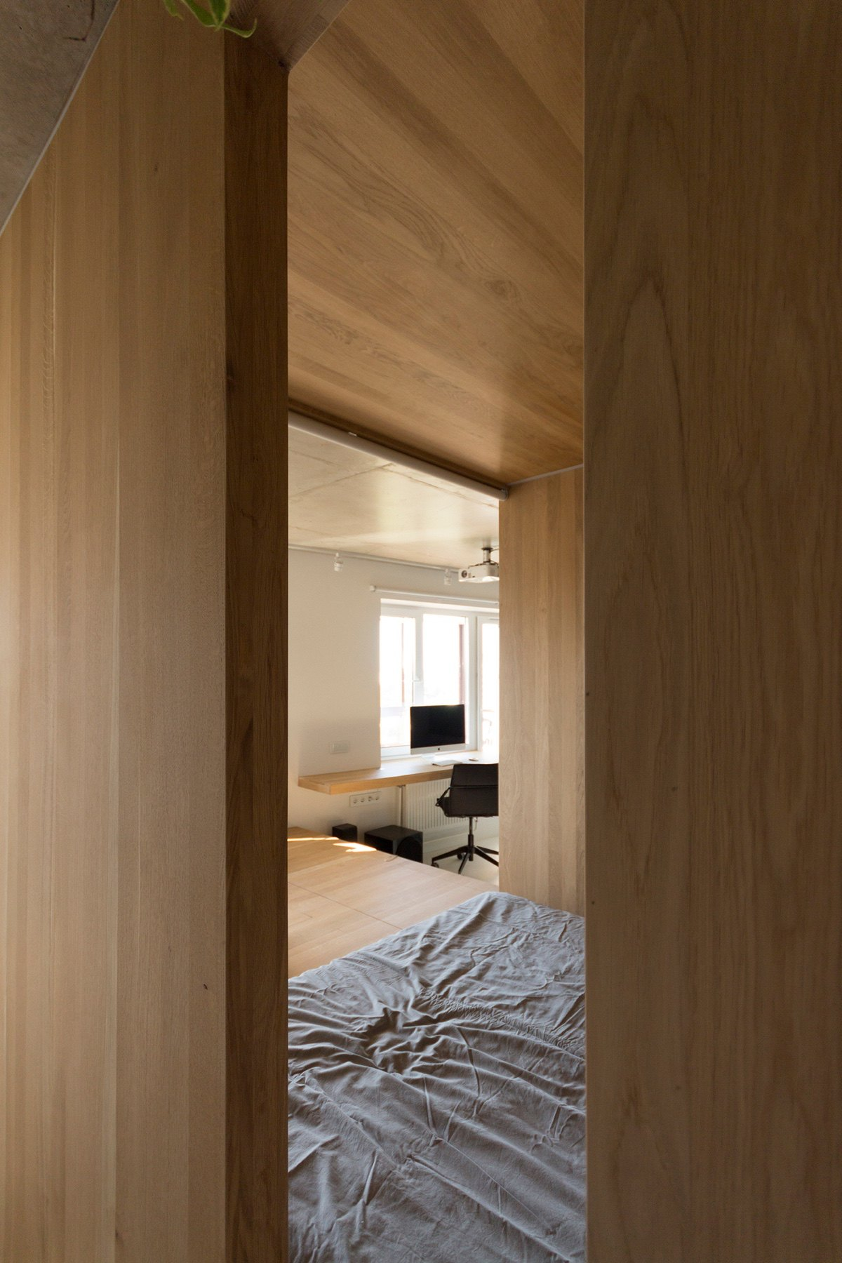 View Through Inside Window Minimalist Bedroom Grey Bedding Light Wood - Super small studio apartment under 50 square meters includes floor plan