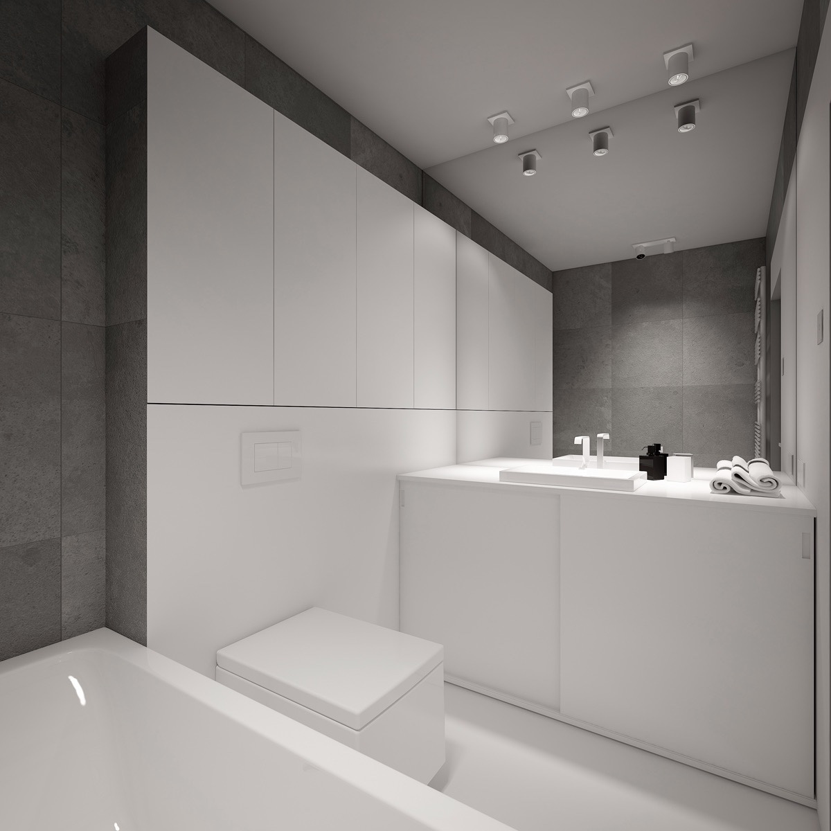 White walls run through to the bathroom, through the use of high cabinetry. With an all-white porcelain bath and toilet, high-block sinks and splash-back wall, large-format slate tiles are a welcome break.