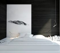 Make your bed go beyond, as a painting headboard changes its shape. This room shows an L-shape shrouded in black-painted wood and white book jackets.