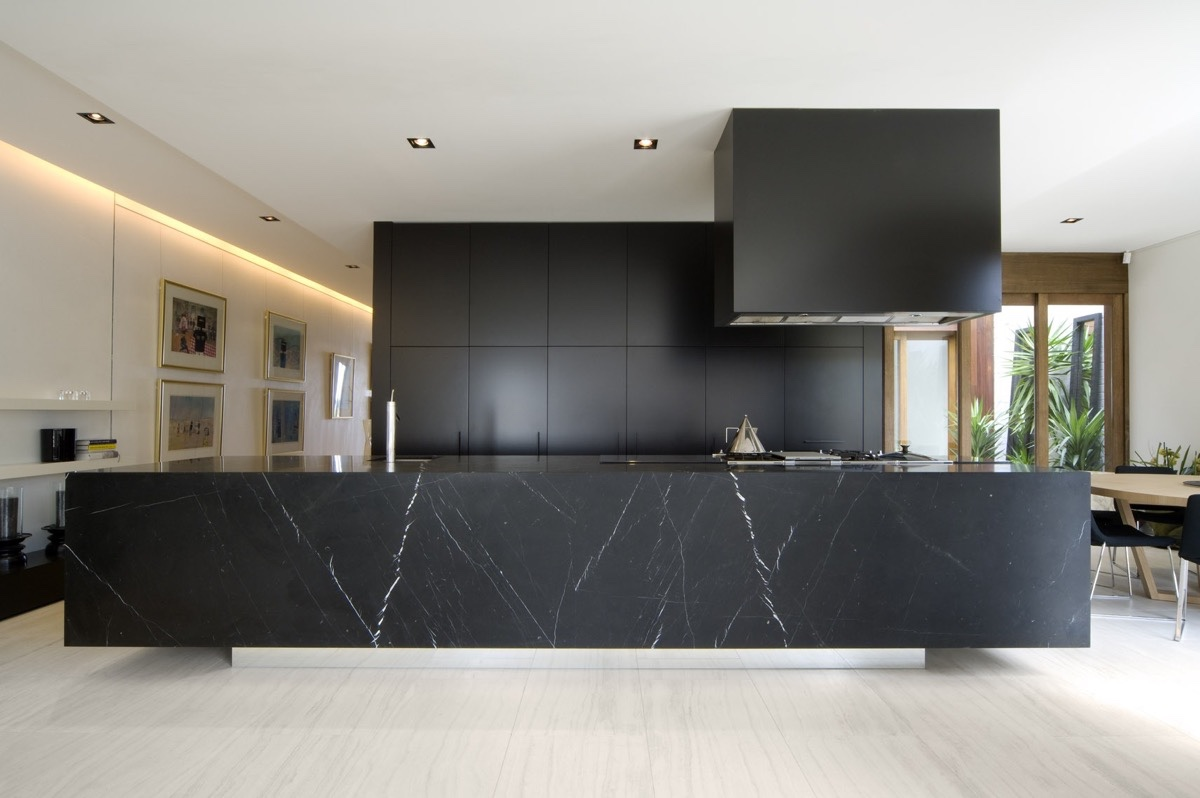 Block Black Kitchen Large Marble Block Benchtop Wooden Flooring - 36 stunning black kitchens that tempt you to go dark for your next remodel