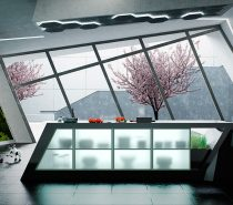 Let's start with something totally out of the ordinary. This kitchen builds off uniquely angled architecture with a trapezoidal island. The result is a surreal environment that turns spatial perception on its head.