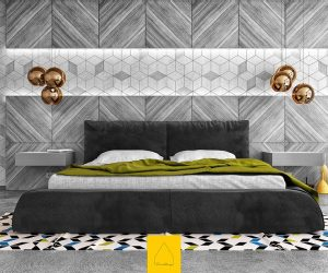 Patterned to perfection, this grey bedroom uses stripes, hexagons and concrete to provide a canvas for autumnal hues. Bronze bauble lights and olive green are set upon by pops of yellow, blue and black in a rug and ornaments.