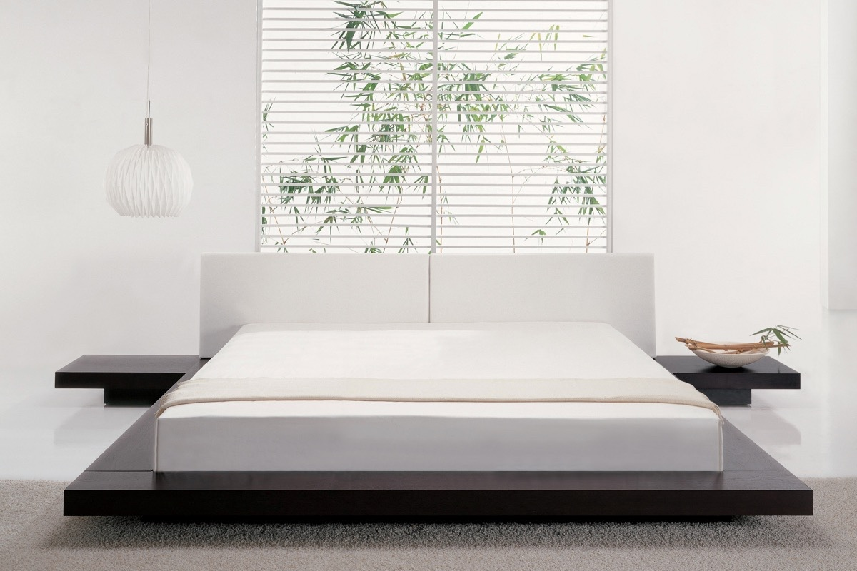 low height  floor bed designs that will make you sleepy - if your home already has plenty of storage sweeping or vacuuming around alow lip like this would make bedroom cleanup a breeze compared to trying to