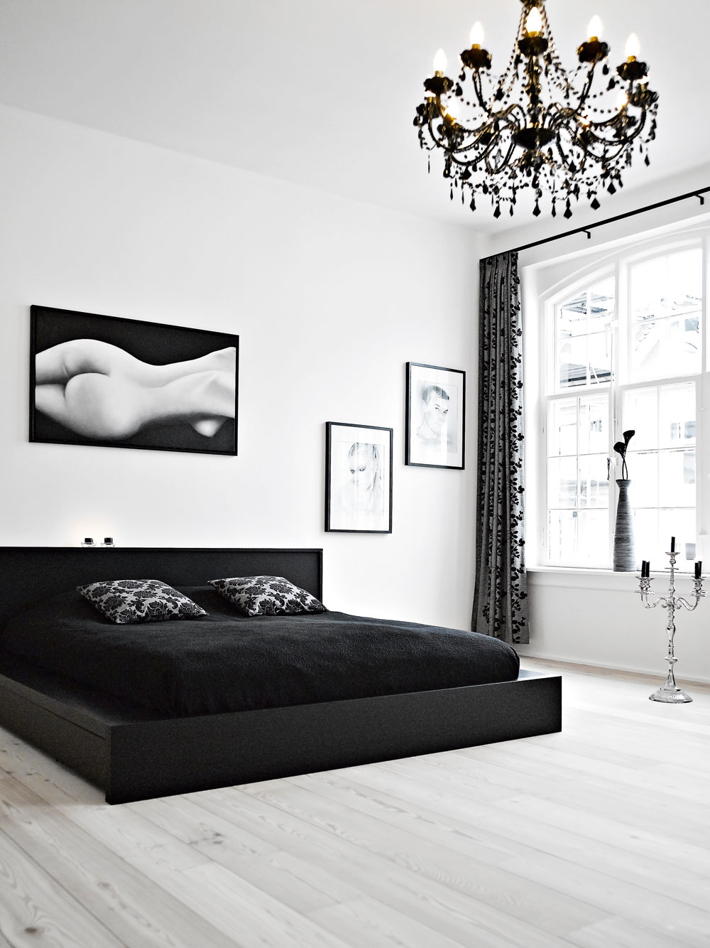 monochrome chandelier black and white bedroom