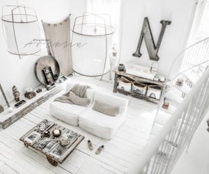 Delicate fabrics and distressed paint weave a breezy, welcoming atmosphere. The grey and white color theme might have felt too cool without the addition of warm rusted metal and naked wood.