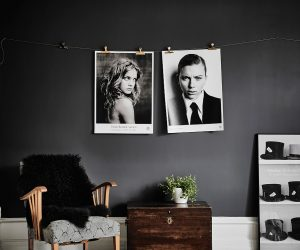 Our first black-and-white, Scandinavian space evokes film noir. Measuring a small 57sqm, it takes advantage of existing plaster decorations and woodwork by using bold, dramatic colours. The living space shows this best, with impactful black encasing the walls. Large-scale monochrome photographs hang off a string line, matched by a case of top hats near the bottom. Different-wooden chairs are softened by black throws and pops of life, while white accents emerge in door frames and illustrated ceiling coves.