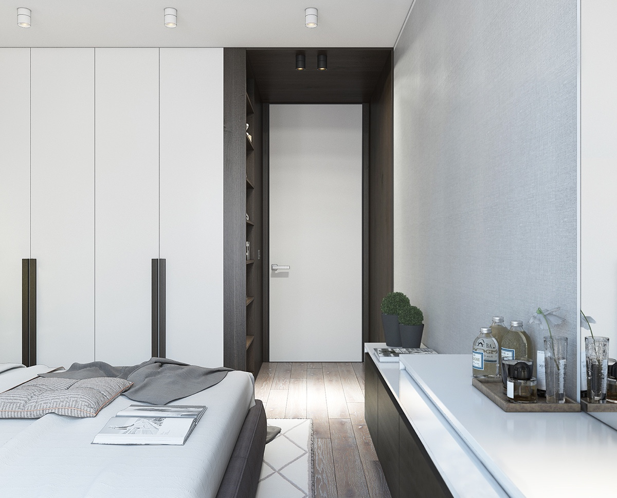 Clever Wardrobe Cubby Hole Doorway Contemporary Bedroom - Spacious looking one bedroom apartment with dark wood accents