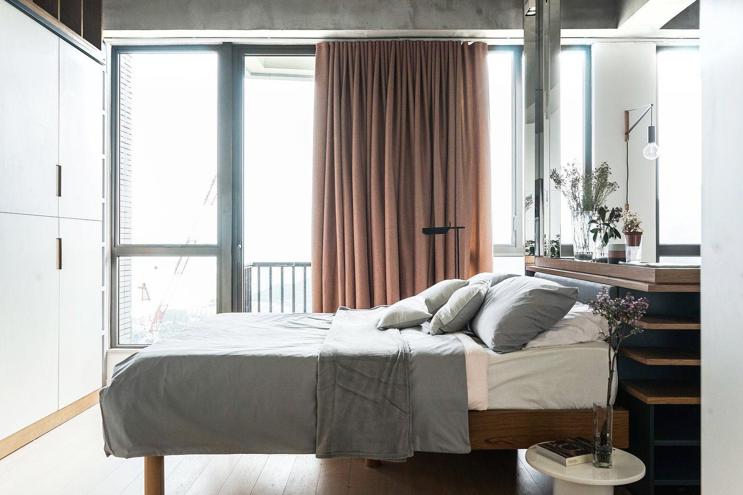 Taupe Curtains Grey Duvet Contemporary Bedroom - 3 small studio apartments that exude luxurious space