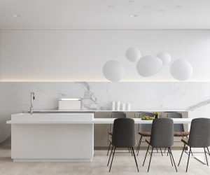 This white kitchen breaks it up, with white marble streaking grey against a minimal backdrop. Taupe cabinetry and wood-and-charcoal chairs help mix the palette, while white decorations float to the ceiling.