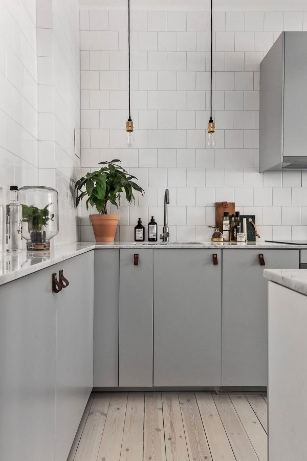Create A Grey And White Kitchen By Combining Dark Charcoal Benches With Side Cabinetry Wind Chime Lighting Can Help Designate The Dining Area