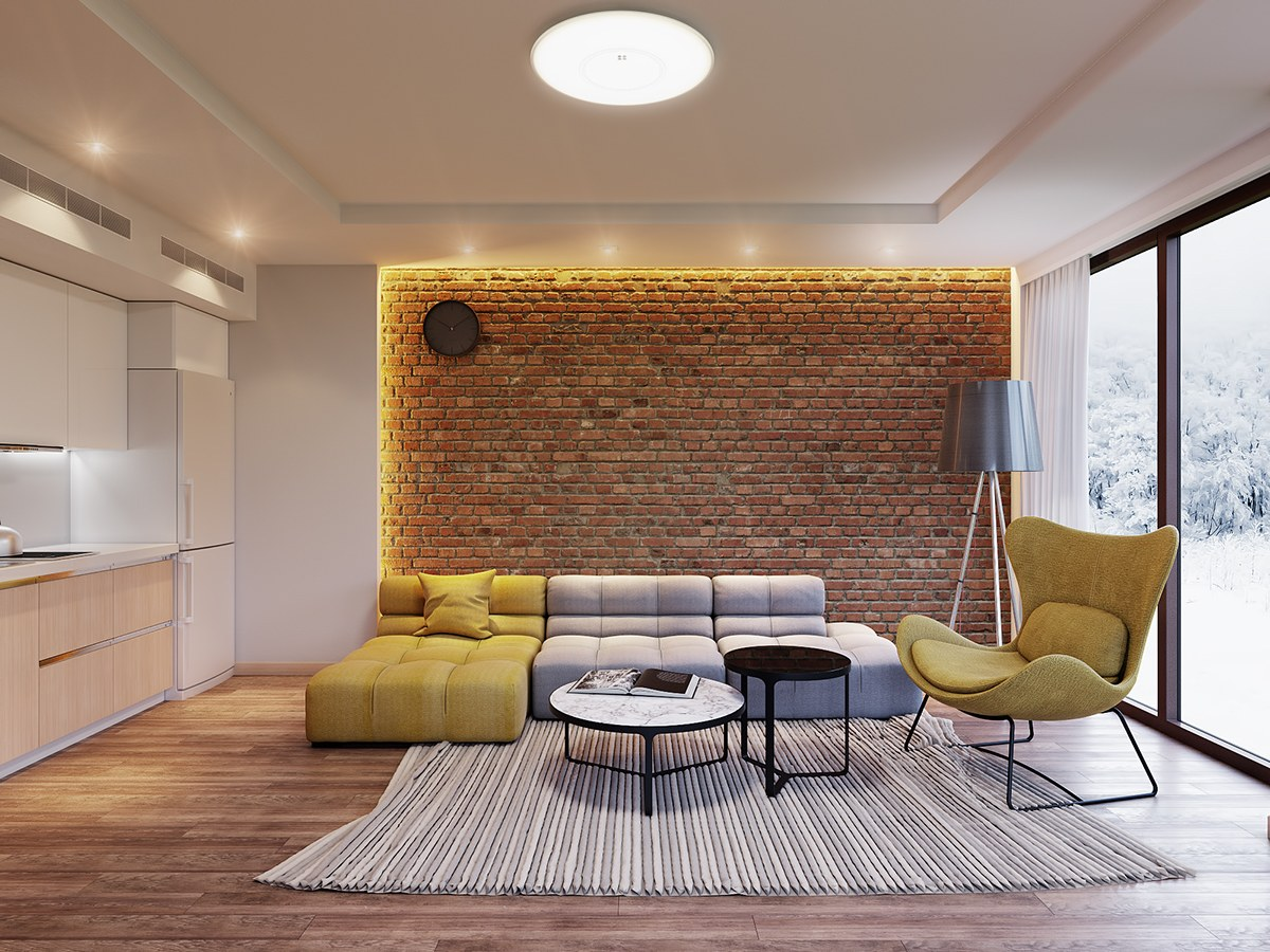 Let Exposed Brick Make A Stand In LED Framing. A Round Circular Light Sets  The Stage For Quilted Block Futons And A Grey Bamboo Rug.