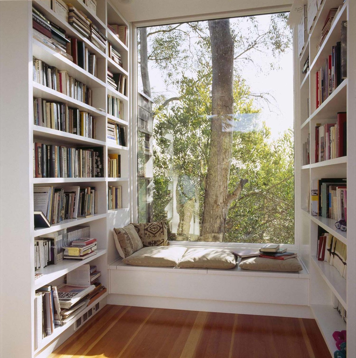 White Simple Bookcase Wedged Nook Corner - 50 best reading nooks we have ever come across