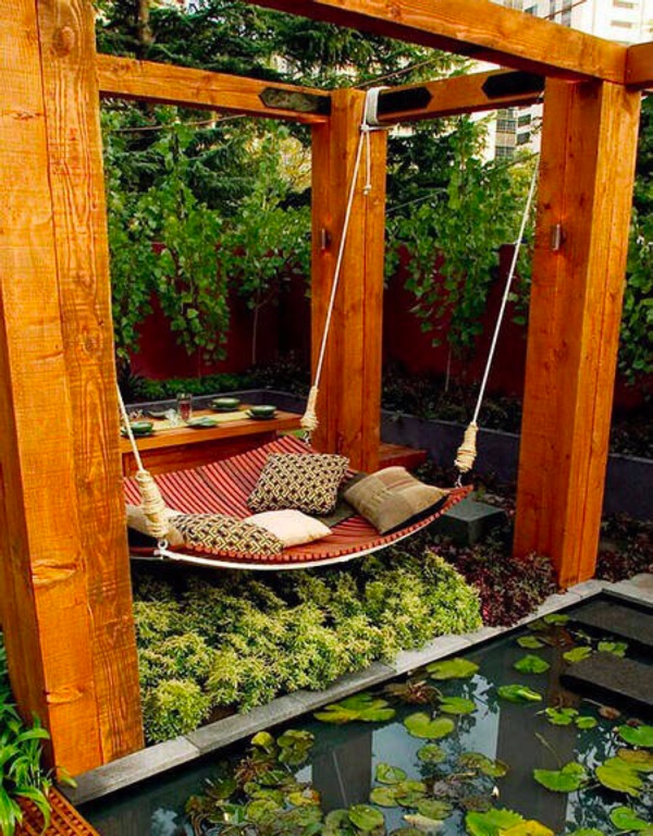 Wooden Hammock Hanging From Four Pillars Outdoor Reading Space - 50 best reading nooks we have ever come across