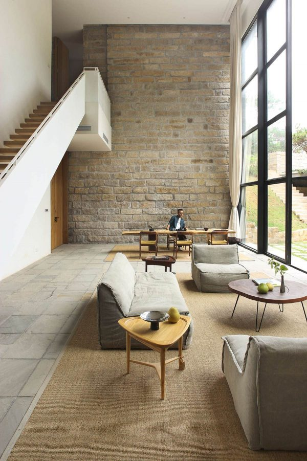 The designer uses various wood finishes to add interest here with the tables are one of the few use of curves in the home the dining table gives an