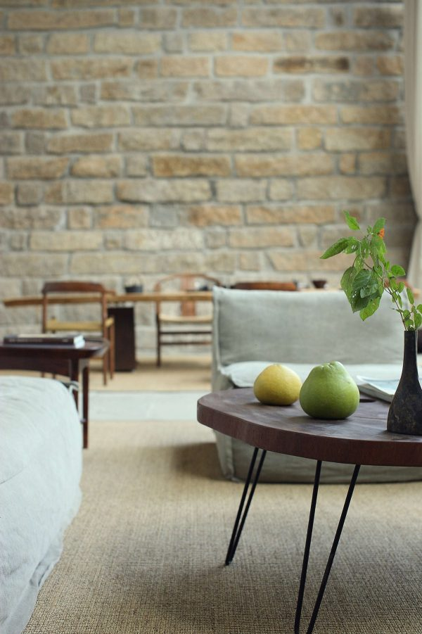 The décor throughout the home is simple the pair of fruit and sprig of leaves in the vase is all this space needed and brings more of the garden inside