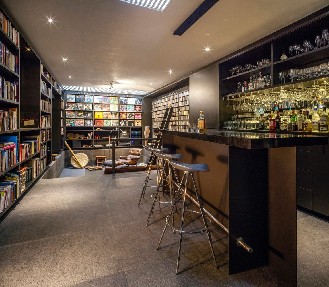 Bar Living Stylish Modern Library - This gorgeous home is a nature loving bookworm s paradise