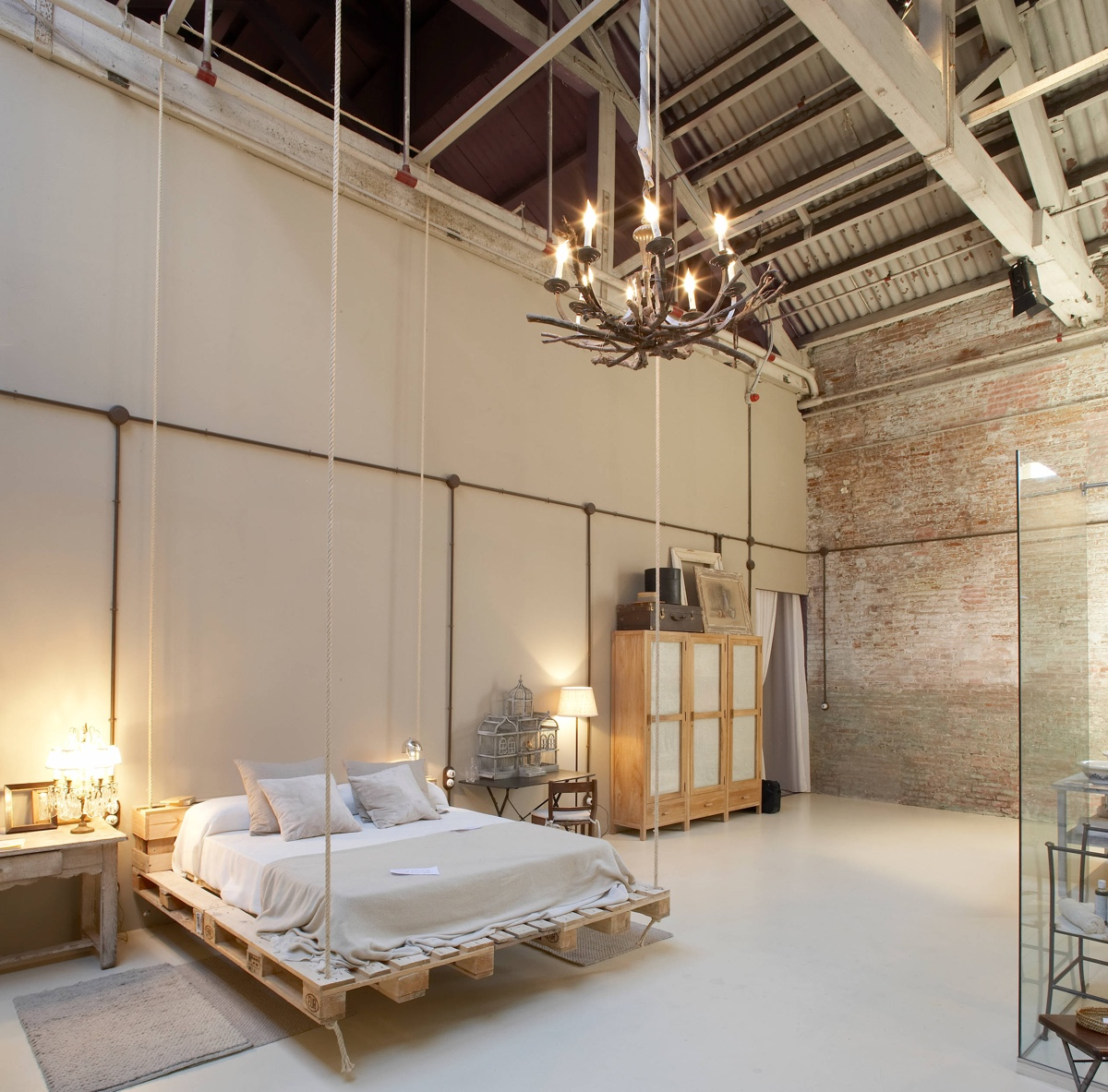Barn Style With Chandelier Exposed Brick Bedroom - Bedrooms with exposed brick walls