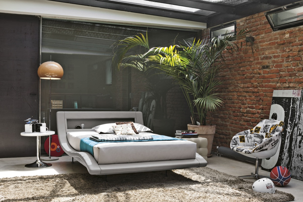 Lush Jungle Bedroom With Exposed Brick - Bedrooms with exposed brick walls