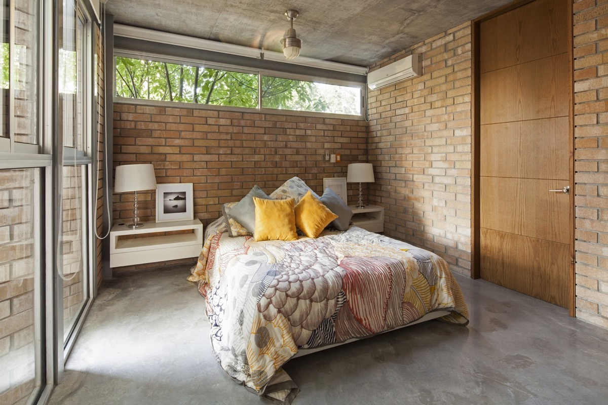 Small Brown Hued Exposed Brick Bedroom - Bedrooms with exposed brick walls