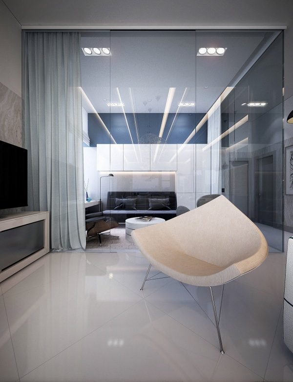 This view into the convertible lounge and bedroom from the living area shows panels in sheer blue that can provide some privacy for the room