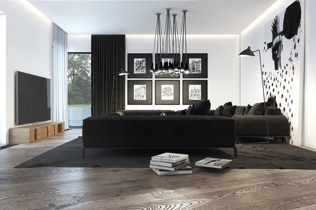 Black Modern Living Room Stack Of Books Hanging Lights Large Tv Large Wall Art Picture Frames Black Couches - 30 black white living rooms that work their monochrome magic