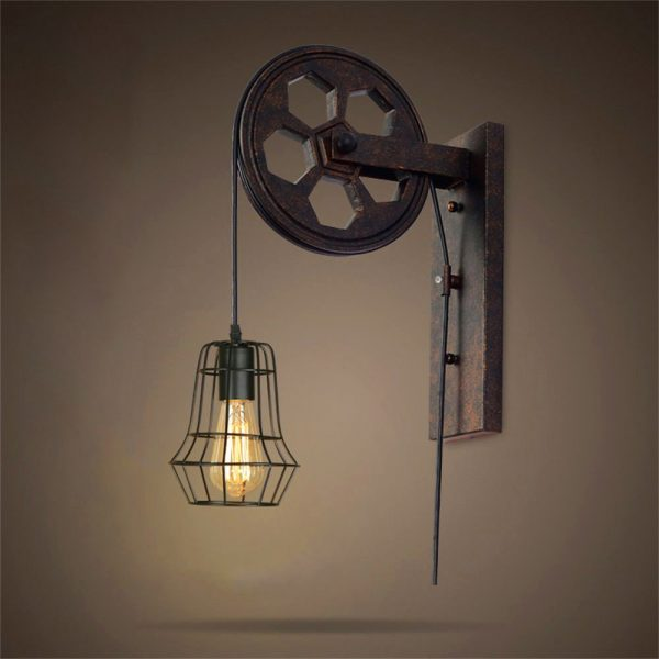 30 industrial style lighting fixtures to help you achieve industrial style bedside wall lamp black wrought iron steals the scene in this vertical light bulbs on either side create a sleek look unusual for aloadofball Images