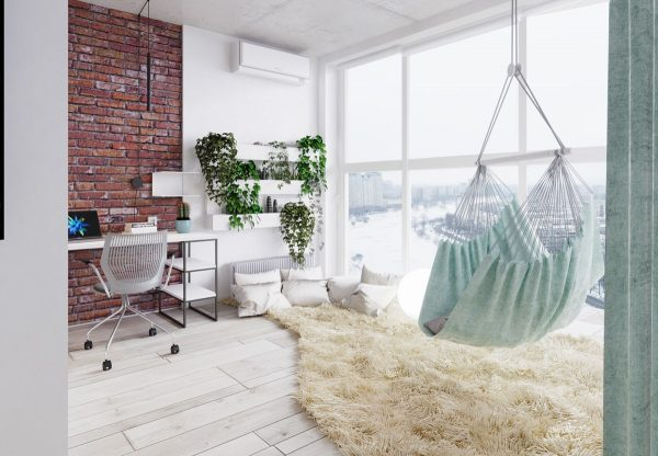 In the corner a cozy lounge space offers respite from a long day of work the hammock is an especially enviable addition soaking up the skyline view from