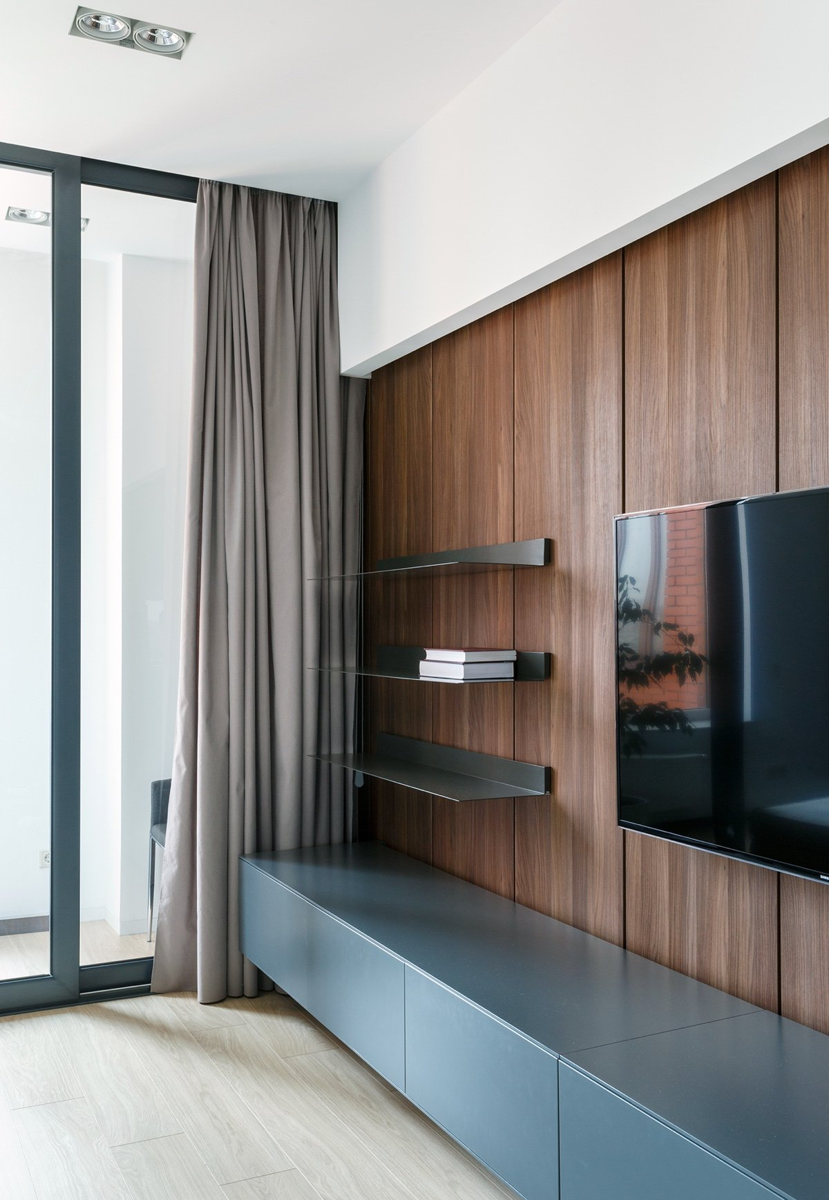 Home Media Room Storage Ideas - A pair of stylish apartments that put their extra rooms to good use