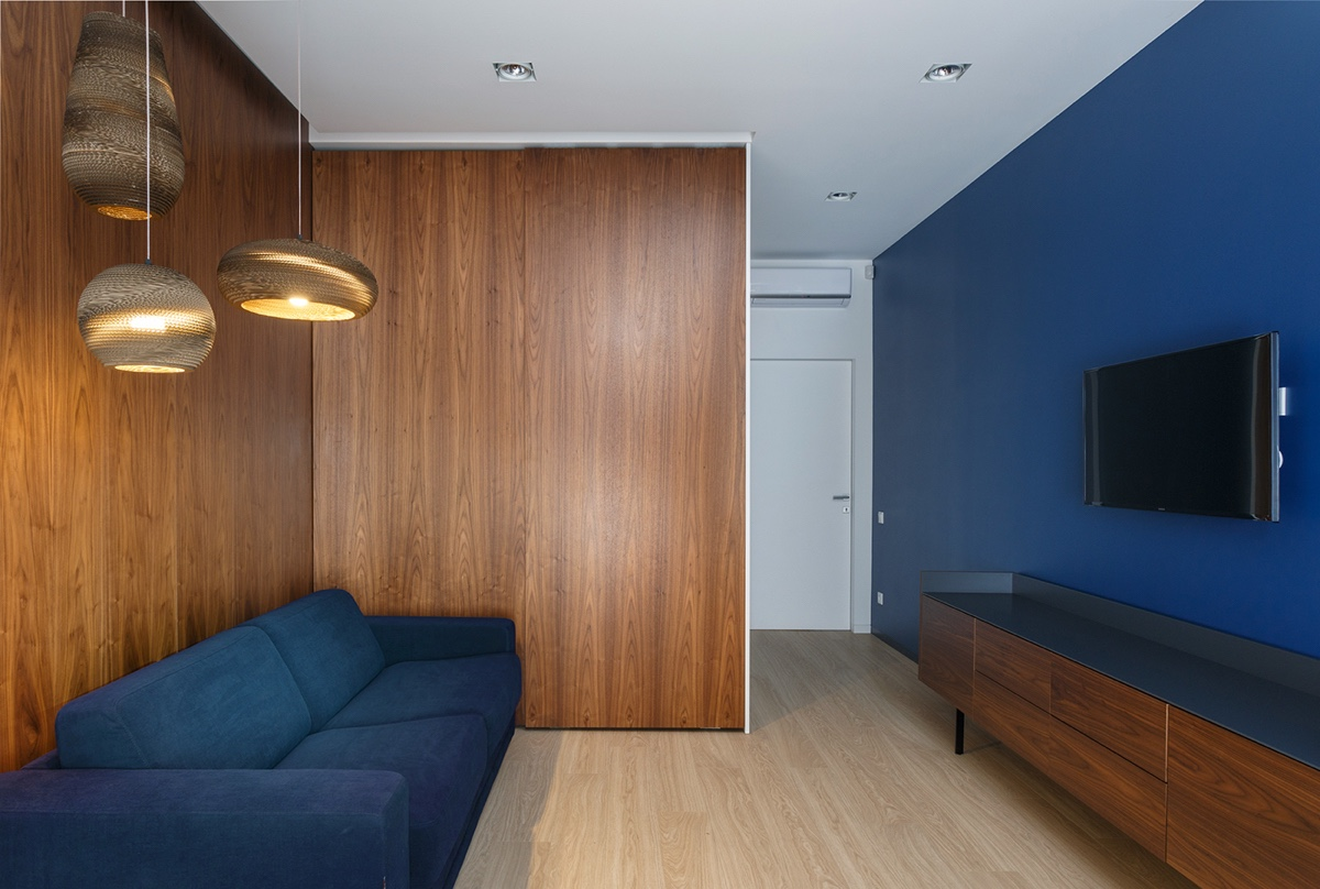 Home Media Room With Dark Blue Walls Inspiration - A pair of stylish apartments that put their extra rooms to good use