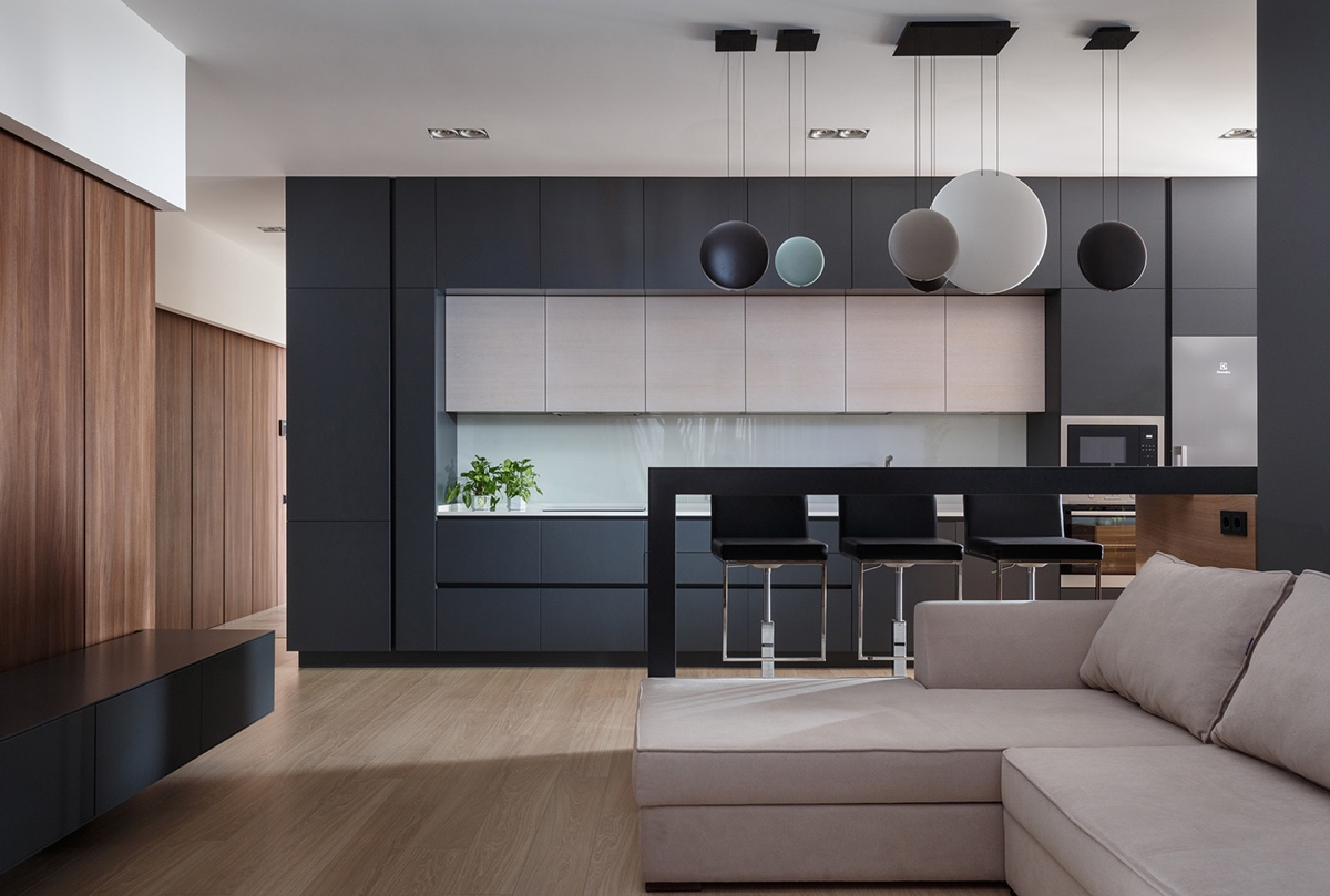 Modern One Bedroom Apartment With Dark Color Scheme - A pair of stylish apartments that put their extra rooms to good use