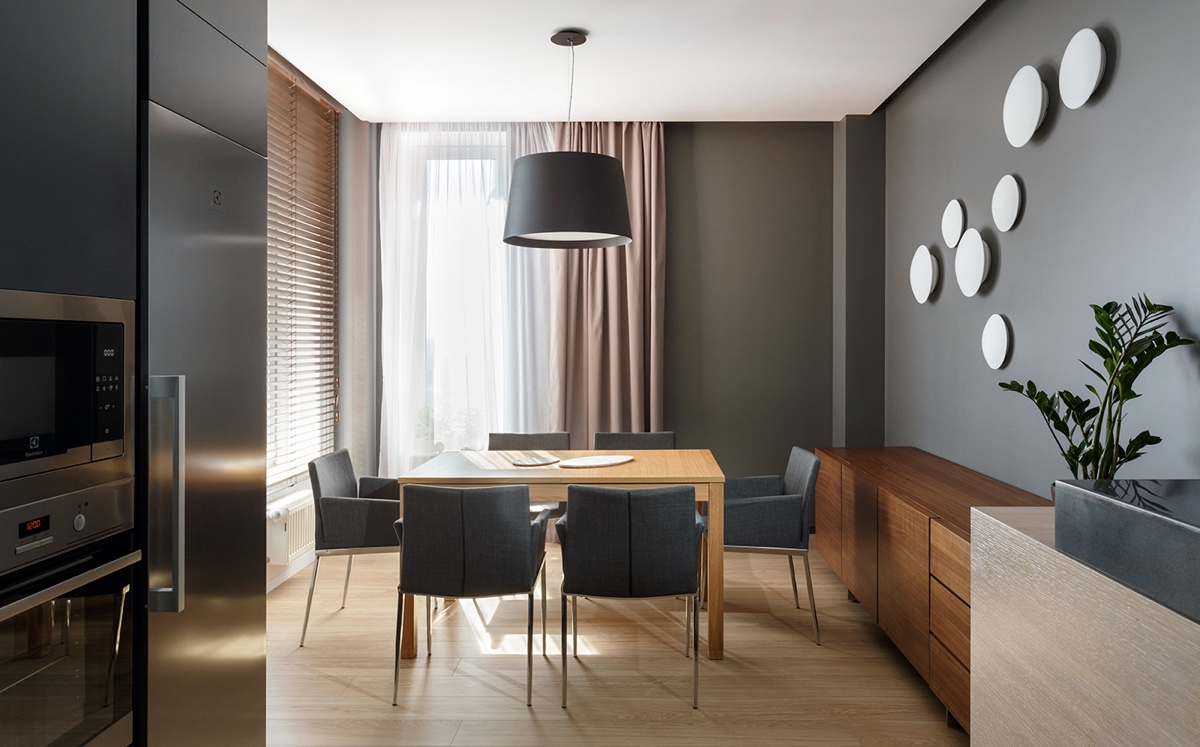 Round Wall Decor In Dining Room - A pair of stylish apartments that put their extra rooms to good use