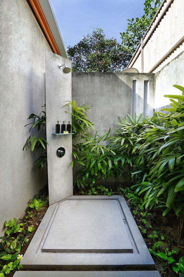 Stone With Ferns Outdoor Shower Drainage - 50 stunning outdoor shower spaces that take you to urban paradise