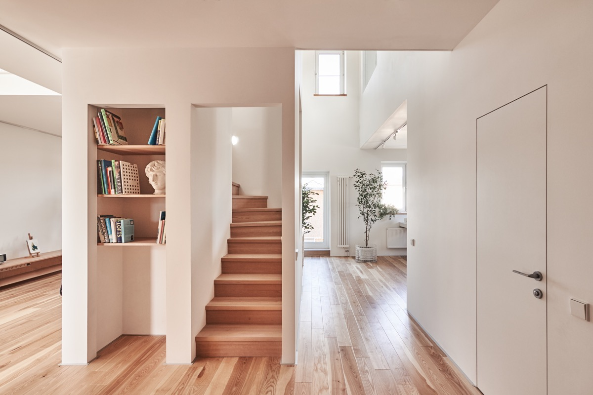 Built In Shelving Ideas - A white and wood house for a stylish family