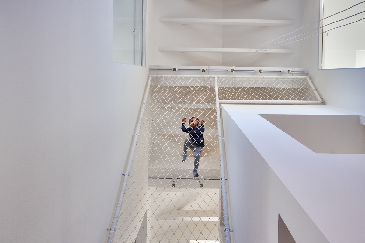 Indoor Climbing Wall - A white and wood house for a stylish family
