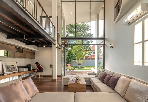 A wall of windows absolutely lavishes the interior with light oversized doors on either end swing open to move the breeze through the interior