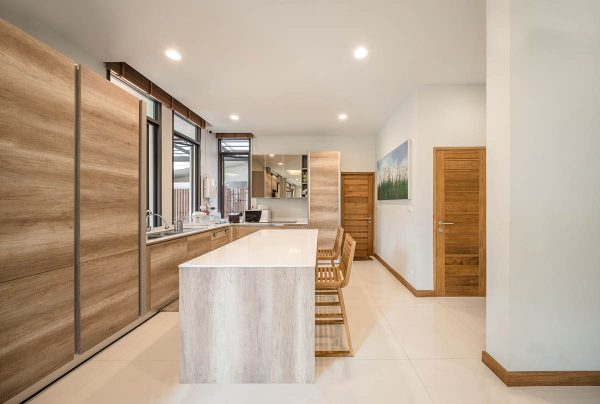 Honey toned wood lends this space a sense of warmth and comfort the perfect ambiance for an area that traditionally serves as the heart of a home