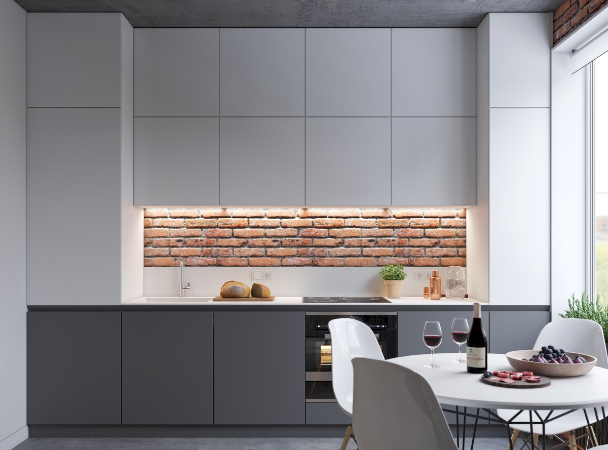 Minimalist Kitchen With Exposed Brick Wall - 5 studio apartments with inspiring modern decor themes