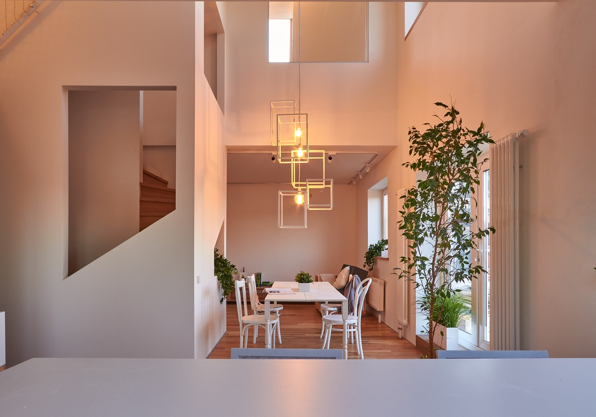 Modern Dining Room - A white and wood house for a stylish family