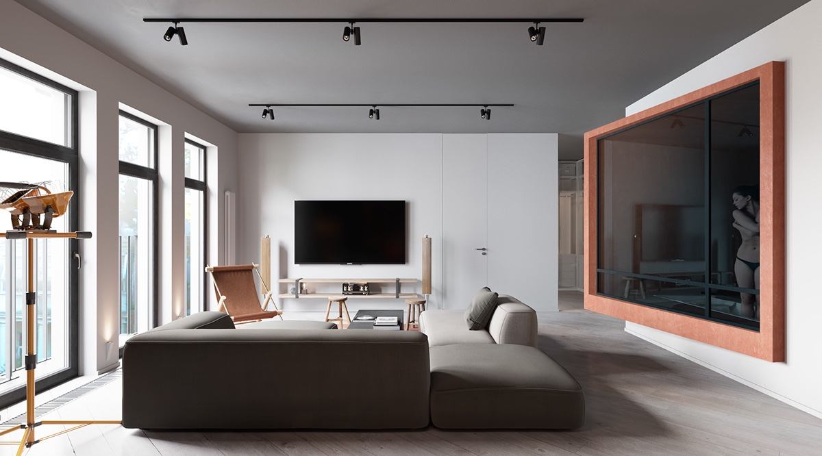 Modern Living Room - A sleek apartment the divides rooms creatively
