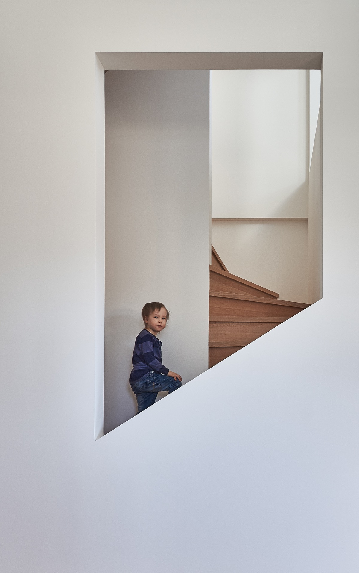 Modern Spiral Staircase - A white and wood house for a stylish family