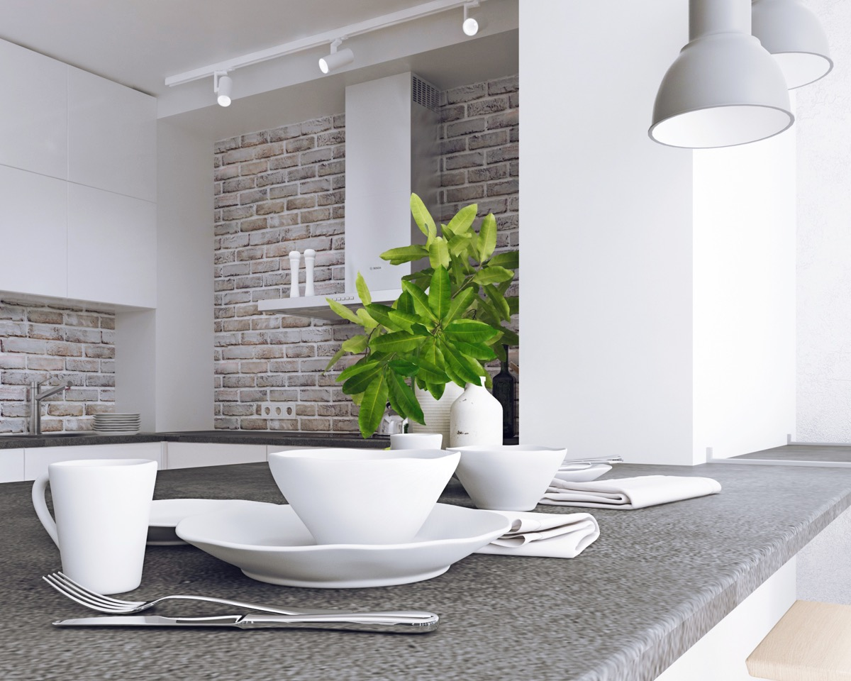 Modern White Washed Exposed Interior Brick - 5 studio apartments with inspiring modern decor themes