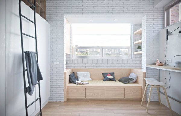 As sunlight streams in from a recessed window it makes this reading nook living area exceptionally welcoming