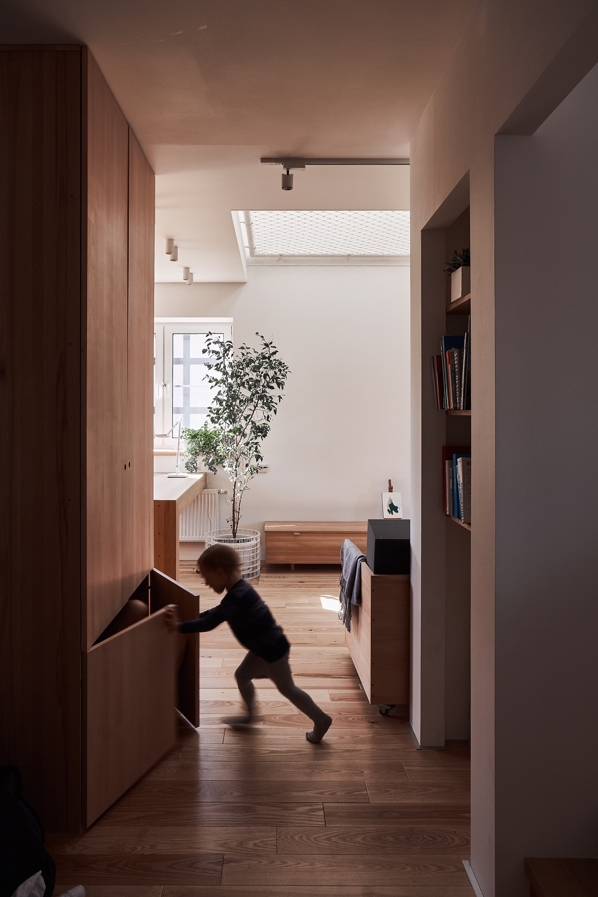 Storage Solutions - A white and wood house for a stylish family